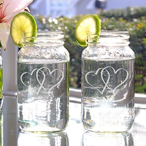 Two Hearts 26-ounce Mason Jars Set of 2, These dual heart mason jars make great drinking glasses, as well as unique decorative vases