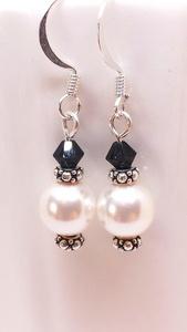 White pearl dangle earrings with jet Swarovski crystal.