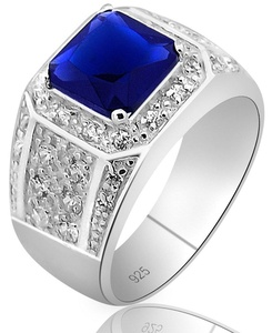 Men's Elegant Sterling Silver .925 High Polish Princess Cut Ring Featuring a Synthetic Blue Sapphire Stone Surrounded by 32 Fancy Round Prong-Set Cubic Zirconia (CZ) Stones.